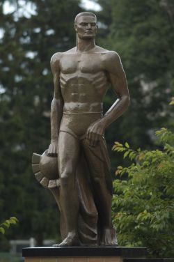 picture of sparty statue, he is holding the spartan helmet in his right hand