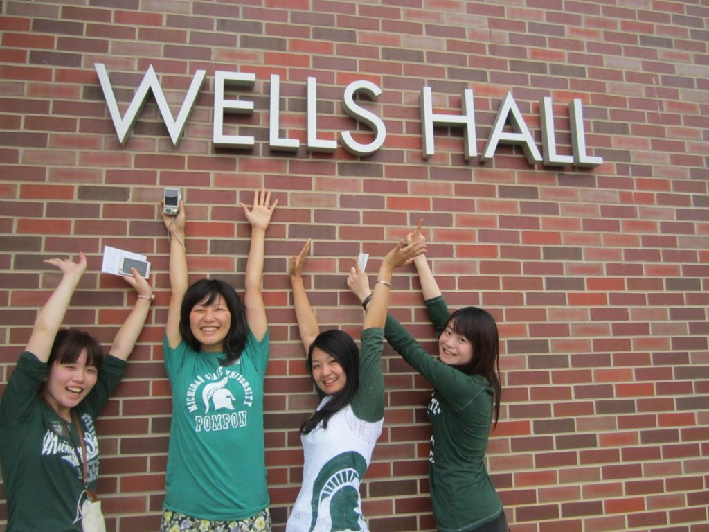 Students in Front of Wells Hall
